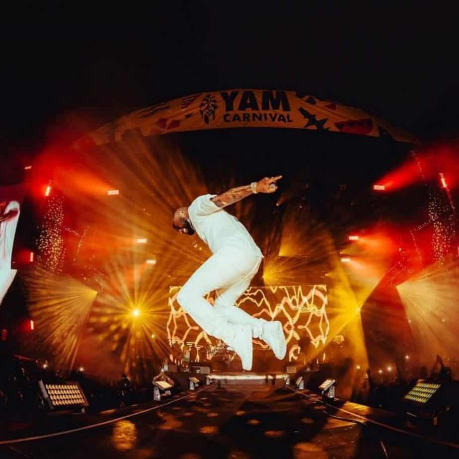 Davido mid air whilst performing at YAM festival 2021